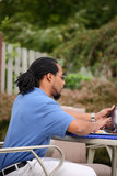 Man Using A Tablet Computer. A handsome young man using a tablet computer outside on a nice day Royalty Free Stock Photo