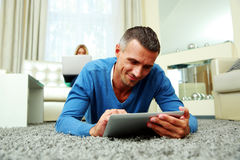 Man using a tablet computer Stock Images