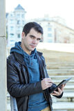 Man Using Tablet Computer In The Street. Royalty Free Stock Photos