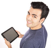 Man using tablet computer or iPad. Beautiful happy Hispanic man  smiling and using a tablet computer isolated on white Stock Images