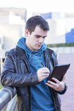 Man using tablet computer, outdoor. Royalty Free Stock Images