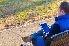 Man using tablet computer outdoors Royalty Free Stock Photography