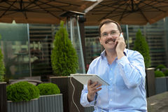 Man using tablet computer outdoors royalty free stock image