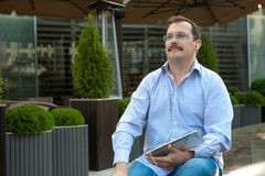 Man using tablet computer outdoors Stock Images