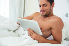 Man using tablet computer Royalty Free Stock Image