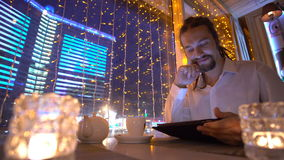 Man using tablet computer touchscreen in cafe stock footage