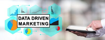 Data driven marketing concept with man using a tablet. Man using a tablet with data driven marketing concept stock images