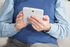 Man using tablet. Elderly man using tablet at work Stock Photos