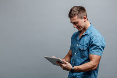 Man using tablet royalty free stock images