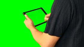 Man using tablet with green screen doubled on big screen 1 from 5. Chroma key green screen. HD. Man using tablet with green screen doubled on big screen. Male stock video