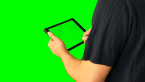 Man using tablet with green screen doubled on big screen 5 from 5. Chroma key green screen. HD. Man using tablet with green screen doubled on big screen. Male stock video