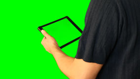 Man using tablet with green screen doubled on big screen 4 from 5. Chroma key green screen. HD. Man using tablet with green screen doubled on big screen. Male stock video