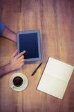 Man using tablet having coffee Stock Image