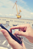 Man using a tablet in an industrial park Royalty Free Stock Image