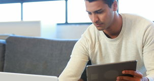 Man using tablet and laptop stock video footage