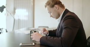 Man using tablet in Office finance background. Young Man Using Digital Tablet in Office stock video