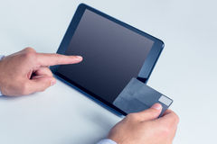 Man using tablet for online shopping Royalty Free Stock Photo