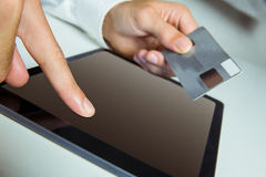 Man using tablet for online shopping Royalty Free Stock Image