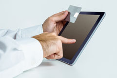 Man using tablet for online shopping Stock Photos