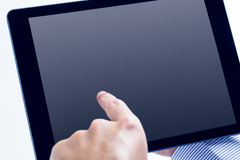 Man using a tablet pc Royalty Free Stock Image