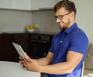 Man using tablet pc at home Stock Images