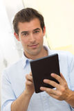 Man using tablet pc indoor Royalty Free Stock Images