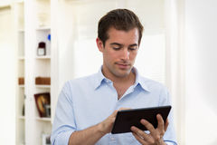 Man using tablet pc indoor Royalty Free Stock Photography