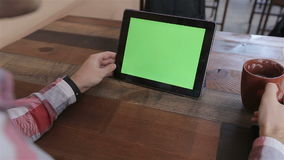 Man Using Tablet PC in Landscape Mode at Home.Tablet with Green Screen. stock video footage