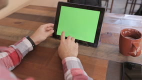Man Using Tablet PC in Landscape Mode at Home.Tablet with Green Screen. stock video