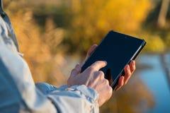 Man using tablet pc outdoors Stock Photos