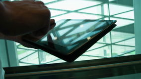 Man using tablet Pc. With various hand gestures (scrolling, touching,typing) indoors stock footage