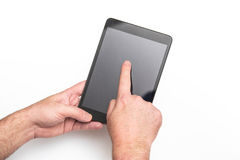 Man using a tablet. White background. Royalty Free Stock Photography