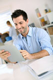 Man using tablet at work Stock Photography