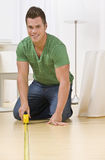 Man Using Tape Measure Royalty Free Stock Photography