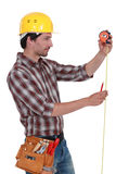 Man using tape measure Stock Images