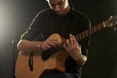 Man Using Tapping Technique On Acoustic Guitar Stock Images