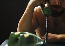 Man using telephone on tension talking Stock Image