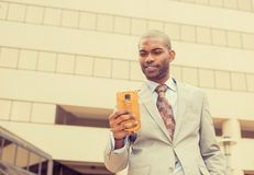 Man using texting on smart phone reading news Stock Image