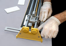 Man Using Tile Cutter Stock Photo