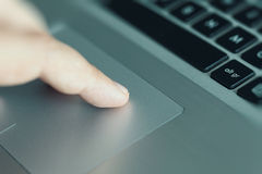 Man using touchpad on laptop Royalty Free Stock Photos