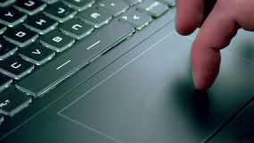 Man using touchpad on notebook keyboard. With his finger stock video footage