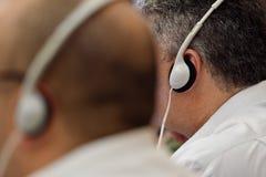 Man using translation headphones Stock Image