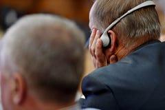 Man using translation headphones Stock Images