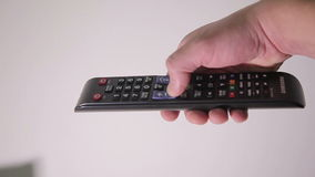 Man Using the TV Remote stock video footage