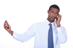 Man using two phones Royalty Free Stock Photography