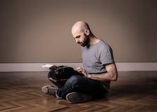 Man using typewriter royalty free stock images