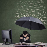Man using umbrella for hiding from tax Stock Images