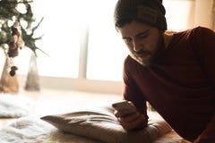 Man using a vaper and smartphone. Winter and Christmas Season stock photos