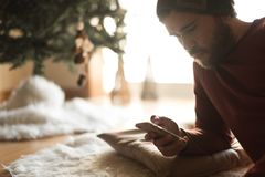 Man using a vaper and smartphone. Winter and Christmas Season royalty free stock photography