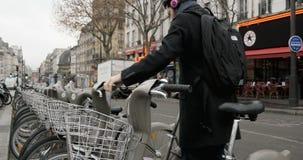 Man using velib Bike renting stock video footage
